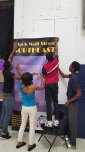 Students from Beverly's Momma's Safe Haven Non-Profit Organization volunteer to help prepare for the 3rd Annual Black Wallstreet Southeast event (June 2016)